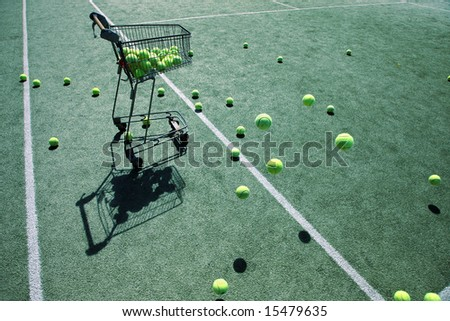 Cart and bouncing tennis balls