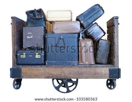 cart full of old luggage on a white background