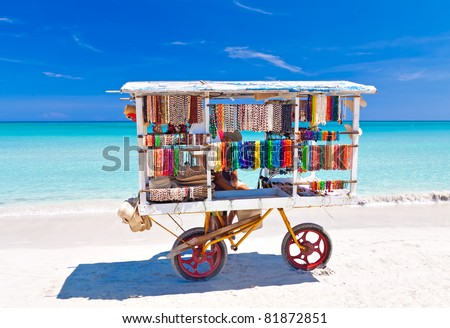 Cart selling typical souvenirs on the beautiful cuban beach of Varadero