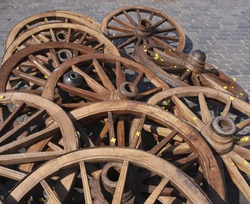 Cart wheels on the old town square. Cobblestone background.