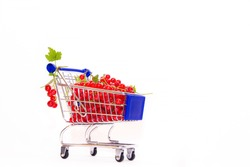 Cart with berries on a white background red currant . Summer berry. Red berries are a whole cartload. Article about berries. Copy space