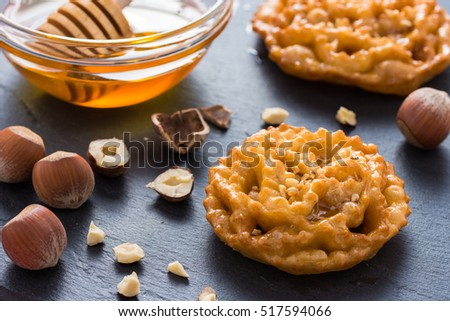 Shutterstock Cartellate, fried dough rings with honey and hazelnuts, traditional dessert of Puglia, Italy.