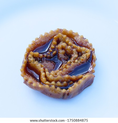 Cartellate with cooked wine. Traditional Apulian sweets, southern Italy Foto stock ©