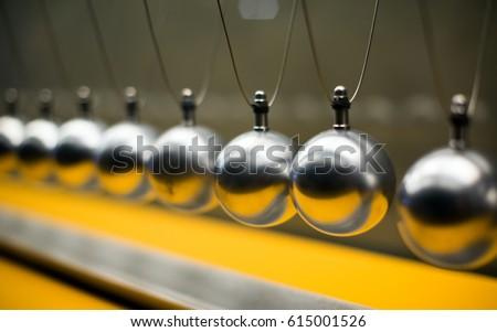 Cartesian impulse conservation law experiment metallic balls #615001526