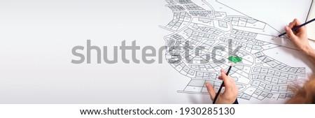 Cartographer Land Map Plot. Cartographer Or Building Developer Сток-фото ©