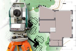 Cartography and geodesy. Work of a surveyor. Measuring equipment in construction. Mapping. Theodolite on the map background. Theodolite near the layout of the house.