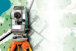 Cartography. Theodolite on the background of a topographic map. Geodesic and cartographic equipment. Study of the area. Mapping. Work of the cartographer. Topography and cartography.