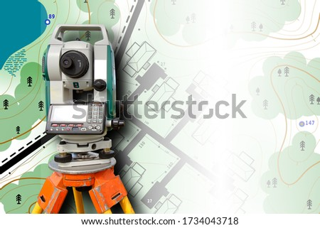 Cartography. Theodolite on the background of a topographic map. Geodesic and cartographic equipment. Study of the area. Mapping. Work of the cartographer. Topography and cartography. Сток-фото ©