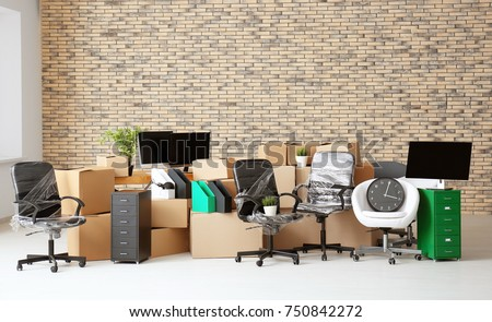 Carton boxes with stuff in empty room. Office move concept Stock photo ©