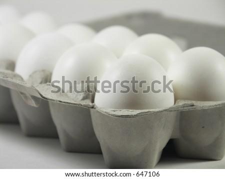 carton of a dozen eggs with focus on front corner of carton