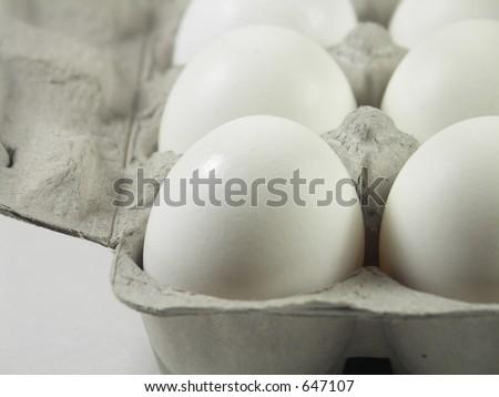 carton of a dozen eggs with focus on front left corner of carton