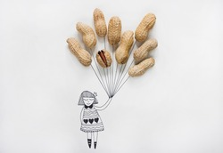 Cartoon of a girl holding real peanuts in her hand like balloons