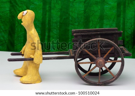 stock photo : Cartoon plasticine character with an empty hand cart