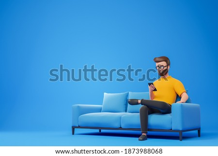 Cartoon smiling beard hipster man in yellow t-shirt and glasses seat on sofa and using smartphone over blue background. 3d render illustration.