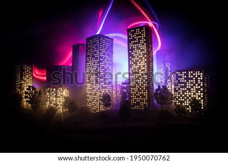 Cartoon style city buildings. Realistic city building miniatures with lights. background. Decorative city. Selective focus Photo stock ©