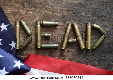 Cartridges on a wooden background inscription about the war #683070619