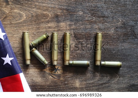 Cartridges on a wooden background inscription about the war #696989326