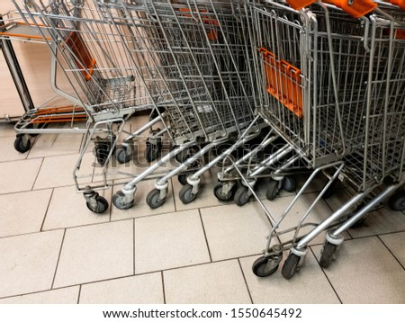 Carts in the supermarket. Carts are grocery. #1550645492