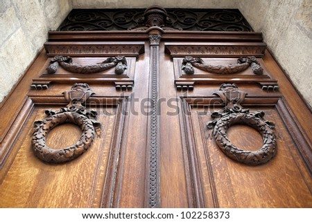 Carved door at the entrance of a mansion