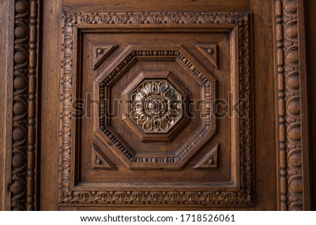 carved door frame with detailed geometric pattern ornament with  gold center piece