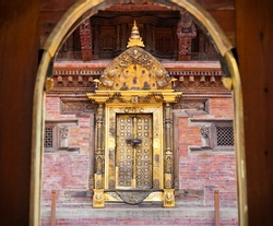 Carved golden door on Mul Chowk at Durbar Sqaure in Patan, Lalitpur city,  Nepal.