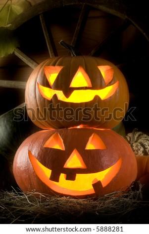 carved halloween pumpkins at night close up shoot