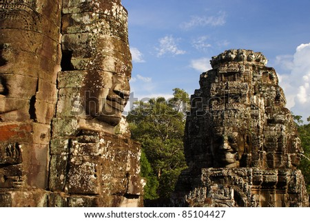 Carved heads of the Bayon temple in Angkor Wat in Cambodia South East Asia
