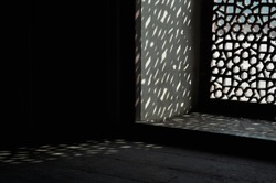 Carved marble lattice window in abstract design texture background in black and white - with space for text