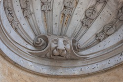 Carved niche with lions head, interesting architectural detail, horizontal aspect