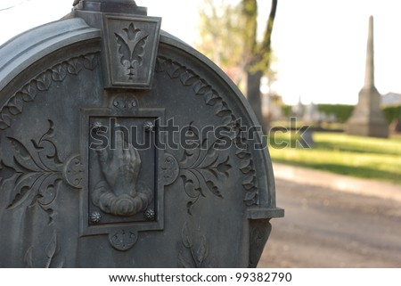 Carved, ornate headstone in a cemetery.