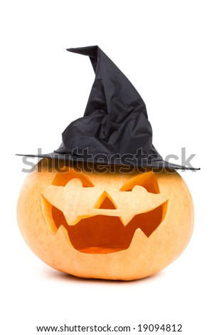 Carved pumpkin in a funny witch hat