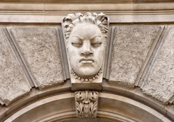 Carved stone angry face in Liverpool on the exterior of the Liver Building