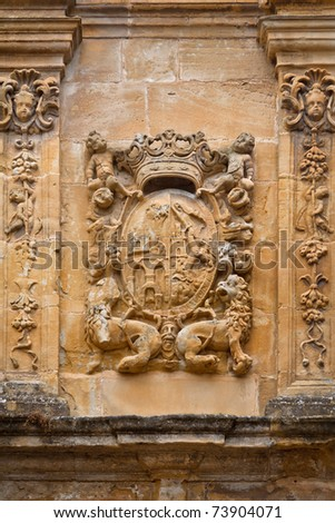 Carved stone coat of arms on the wall, Labastida, Alava, Spain