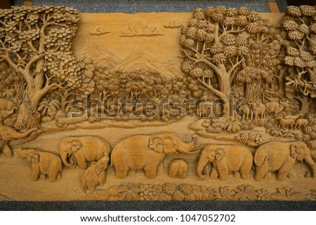 Carved Thai elephant on the wood frame