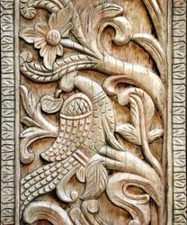 Carved wooden door detail of bird