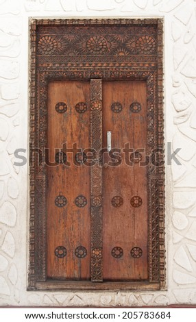 Carved wooden door in Stone Town, Zanzibar, Tanzania