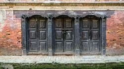 Carved wooden doors at the 9 th century building - Bhaktapur, Nepal