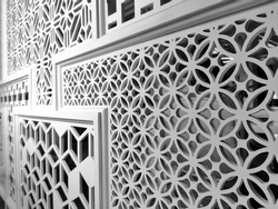Carved wooden lattice work with modern style pattern art. Perforated wooden design in Monochrome background.