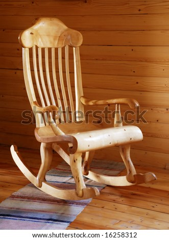 carved wooden rocking-chair in the country-style interior