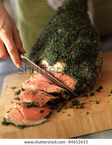 Carving a leg of lamb with herbs
