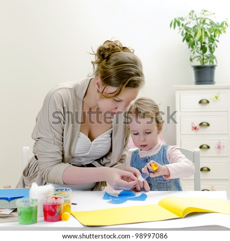 Carving. Mother and daughter doing handicrafts. - stock photo