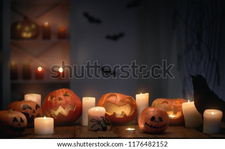 Carving pumpkins on the table at home. Happy Halloween.