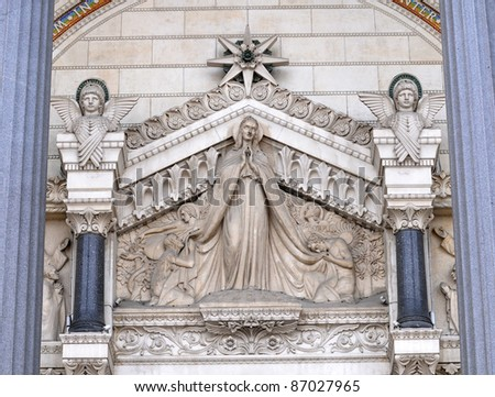 Carvings above main entrance to the Basilica of Notre Dame de Fourviere in Lyon city, France
