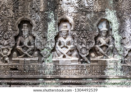 carvings on a wall in Preah Khan temple showing some ascetics, Preah Khan temple, Siem Reap, Cambodia, Asia #1304492539