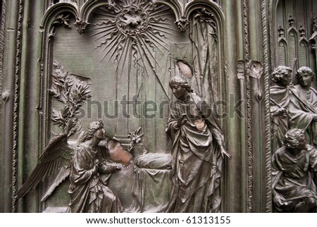 carvings on the doors of a cathedral