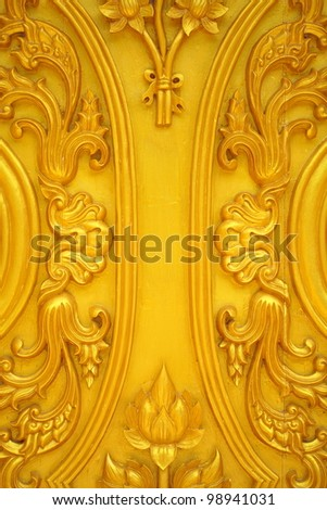 Carvings on the wooden doors of the temple in Thailand.