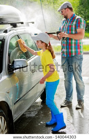 Carwash-young girl with father in carwash.
