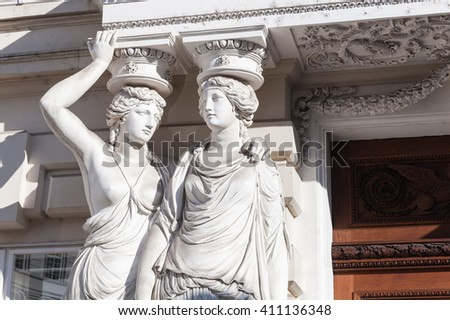 Caryatid. Statues of two young women in form elegant columns supporting a portico, Josefsplatz, Vienna #411136348