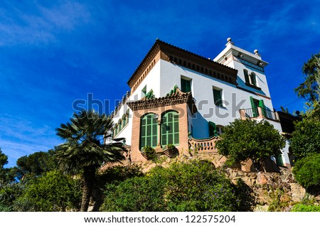 Casa Trias in the Park Guell in Barcelona, Spain against a blue sky