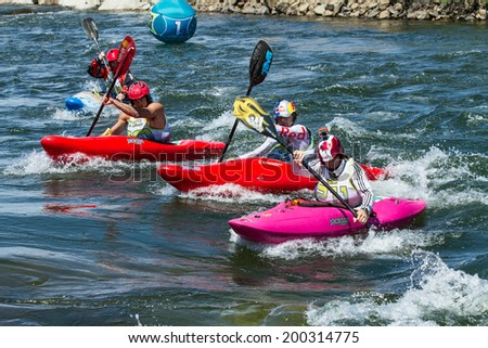 CASCADE IDAHO USA JUNE 21 2014 group of people trying to race to the finish during the kayak portion of the Payette River Games